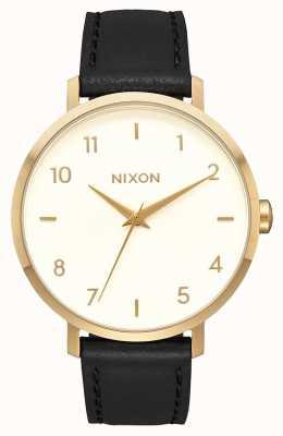 Nixon Skóra ze strzałkami   złoty / kremowy / czarny   czarny skórzany pasek   kremowa tarcza A1091-2769-00